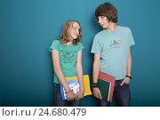 Купить «Teenager, boy, girl, school cases, eye contact, half portrait,», фото № 24680479, снято 21 июля 2018 г. (c) mauritius images / Фотобанк Лори