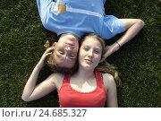 Купить «Teenage couple, meadow, lie, touch,», фото № 24685327, снято 19 марта 2019 г. (c) mauritius images / Фотобанк Лори