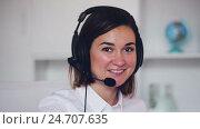 Купить «Female at call-centre», видеоролик № 24707635, снято 7 декабря 2016 г. (c) Яков Филимонов / Фотобанк Лори