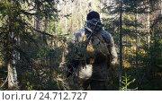 Man hunter outdoor in forest hunting alone. Стоковое видео, видеограф Сергей Кальсин / Фотобанк Лори