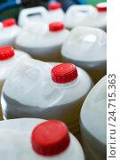 Купить «Group of filled with olive oil plastic containers», фото № 24715363, снято 22 сентября 2018 г. (c) Яков Филимонов / Фотобанк Лори