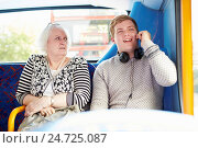 Купить «Man Disturbing Passengers On Bus Journey With Phone Call», фото № 24725087, снято 26 сентября 2013 г. (c) easy Fotostock / Фотобанк Лори