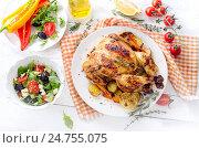 Купить «Roasted chicken with vegetables and salad on a wooden background.», фото № 24755075, снято 20 октября 2016 г. (c) Tatjana Baibakova / Фотобанк Лори