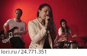 Music group on red background. Стоковое видео, видеограф Chudakov_Ivan / Фотобанк Лори