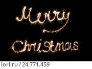 Огненная надпись Merry Christmas на темном фоне. Поздравление с Рождеством. Стоковое фото, фотограф Владимир Семенчук / Фотобанк Лори