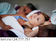 Купить «Couple In Bed With Wife Suffering From Insomnia», фото № 24777751, снято 8 июля 2013 г. (c) easy Fotostock / Фотобанк Лори