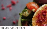 Купить «goat cheese salad with vegetables at restaurant», видеоролик № 24781375, снято 30 сентября 2016 г. (c) Syda Productions / Фотобанк Лори