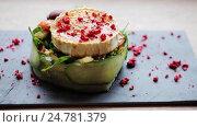 Купить «goat cheese salad with vegetables at restaurant», видеоролик № 24781379, снято 29 сентября 2016 г. (c) Syda Productions / Фотобанк Лори