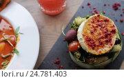 Купить «gazpacho soup, salad and drink at restaurant», видеоролик № 24781403, снято 29 сентября 2016 г. (c) Syda Productions / Фотобанк Лори