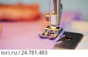 Купить «sewing machine presser foot stitching fabric», видеоролик № 24781483, снято 3 октября 2016 г. (c) Syda Productions / Фотобанк Лори
