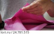 Купить «woman with tailor scissors cutting out fabric», видеоролик № 24781515, снято 3 октября 2016 г. (c) Syda Productions / Фотобанк Лори