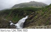 Купить «Водопад в горном массиве Вачкажец. Камчатка», видеоролик № 24784183, снято 15 августа 2016 г. (c) А. А. Пирагис / Фотобанк Лори