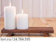 Купить «two large candles burning on a wooden support close up», фото № 24784595, снято 5 марта 2016 г. (c) Константин Лабунский / Фотобанк Лори