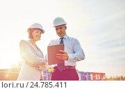 Купить «happy builders in hardhats with tablet pc outdoors», фото № 24785411, снято 21 сентября 2014 г. (c) Syda Productions / Фотобанк Лори