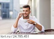man with coffee calling on smartphone at city cafe, фото № 24785451, снято 21 августа 2016 г. (c) Syda Productions / Фотобанк Лори