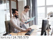 Купить «happy creative team with computer in office», фото № 24785579, снято 29 марта 2015 г. (c) Syda Productions / Фотобанк Лори