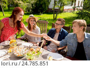 happy friends having dinner at summer garden party, фото № 24785851, снято 28 августа 2016 г. (c) Syda Productions / Фотобанк Лори
