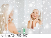 woman in hairband touching her face at bathroom. Стоковое фото, фотограф Syda Productions / Фотобанк Лори