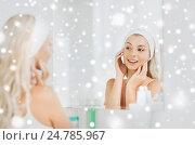 Купить «woman in hairband touching her face at bathroom», фото № 24785967, снято 13 февраля 2016 г. (c) Syda Productions / Фотобанк Лори