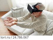 Купить «old man in virtual reality headset or 3d glasses», фото № 24786067, снято 7 июля 2016 г. (c) Syda Productions / Фотобанк Лори