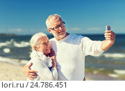 happy senior couple hugging on summer beach, фото № 24786451, снято 18 августа 2015 г. (c) Syda Productions / Фотобанк Лори
