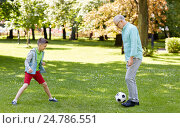 old man and boy playing football at summer park, фото № 24786551, снято 9 июля 2016 г. (c) Syda Productions / Фотобанк Лори