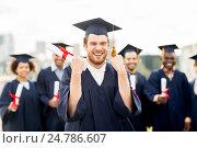 Купить «happy student with diploma celebrating graduation», фото № 24786607, снято 24 сентября 2016 г. (c) Syda Productions / Фотобанк Лори
