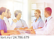 Купить «group of happy doctors meeting at hospital office», фото № 24786679, снято 14 марта 2015 г. (c) Syda Productions / Фотобанк Лори