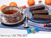 Купить «Десерт с мандаринами, чаем и шоколадным тортом», эксклюзивное фото № 24790607, снято 29 декабря 2016 г. (c) Яна Королёва / Фотобанк Лори