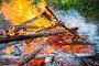 Close-up photo of burning firewood in bonfire, фото № 24798439, снято 1 октября 2016 г. (c) Евгений Сергеев / Фотобанк Лори