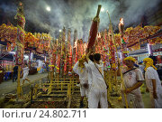 Купить «Lighting prayer poles for merit and good luck at the Vegetarian Festival in Bangkok, Thailand.», фото № 24802711, снято 1 октября 2016 г. (c) age Fotostock / Фотобанк Лори