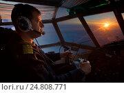 Купить «Пилот в кабине самолета Ан-2», фото № 24808771, снято 16 января 2015 г. (c) Владимир Мельников / Фотобанк Лори