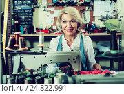 Tailor using sewing machine. Стоковое фото, фотограф Яков Филимонов / Фотобанк Лори