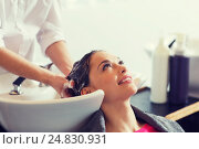 Купить «happy young woman at hair salon», фото № 24830931, снято 15 февраля 2015 г. (c) Syda Productions / Фотобанк Лори