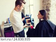 Купить «happy woman and stylist with tablet pc at salon», фото № 24830935, снято 15 февраля 2015 г. (c) Syda Productions / Фотобанк Лори