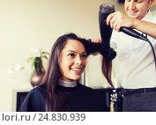 Купить «happy woman with stylist making hairdo at salon», фото № 24830939, снято 15 февраля 2015 г. (c) Syda Productions / Фотобанк Лори