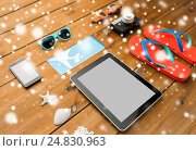 tablet pc, airplane ticket and beach stuff. Стоковое фото, фотограф Syda Productions / Фотобанк Лори