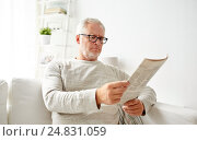 Купить «senior man in glasses reading newspaper at home», фото № 24831059, снято 7 июля 2016 г. (c) Syda Productions / Фотобанк Лори