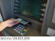 Купить «close up of hand withdrawing money at atm machine», фото № 24831099, снято 8 сентября 2016 г. (c) Syda Productions / Фотобанк Лори