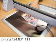 Купить «hand with cash money at bank office or exchanger», фото № 24831111, снято 8 сентября 2016 г. (c) Syda Productions / Фотобанк Лори