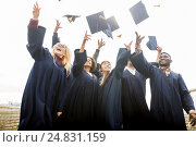 Купить «happy students throwing mortar boards up», фото № 24831159, снято 24 сентября 2016 г. (c) Syda Productions / Фотобанк Лори