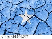 Изображение флага Сомали на потрескавшейся сухой земле. Стоковое фото, фотограф Игорь Долгов / Фотобанк Лори