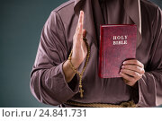 Купить «Monk in religious concept on gray background», фото № 24841731, снято 26 октября 2016 г. (c) Elnur / Фотобанк Лори