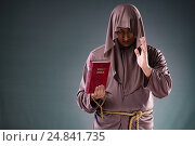 Купить «Monk in religious concept on gray background», фото № 24841735, снято 26 октября 2016 г. (c) Elnur / Фотобанк Лори