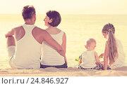Купить «back view on family of four sitting on beach», фото № 24846927, снято 25 апреля 2018 г. (c) Яков Филимонов / Фотобанк Лори