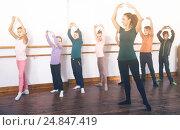 Купить «diligent boys and girls rehearsing ballet dance in studio», фото № 24847419, снято 12 ноября 2016 г. (c) Яков Филимонов / Фотобанк Лори