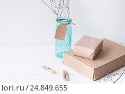 Купить «Minimal elegant composition with turquoise vase and craft boxes», фото № 24849655, снято 29 декабря 2016 г. (c) Екатерина Рыбина / Фотобанк Лори