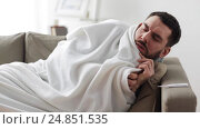 Купить «ill man with thermometer having flu at home», видеоролик № 24851535, снято 10 декабря 2016 г. (c) Syda Productions / Фотобанк Лори