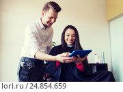 Купить «happy woman and stylist with tablet pc at salon», фото № 24854659, снято 15 февраля 2015 г. (c) Syda Productions / Фотобанк Лори