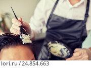 Купить «close up of stylist coloring hair at salon», фото № 24854663, снято 15 февраля 2015 г. (c) Syda Productions / Фотобанк Лори